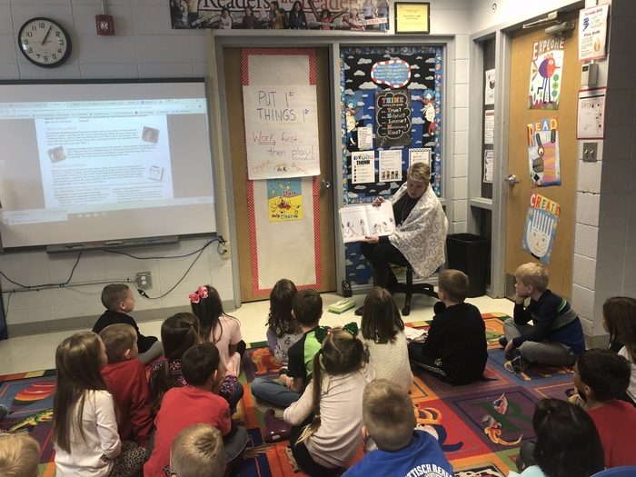 Nurse Goff reading to first grade.