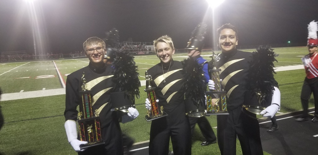TVHS Drum Majors Ben, Kayden and Christian holding trophies after the awards presentation at the 2019 Mt. Zion Music Games